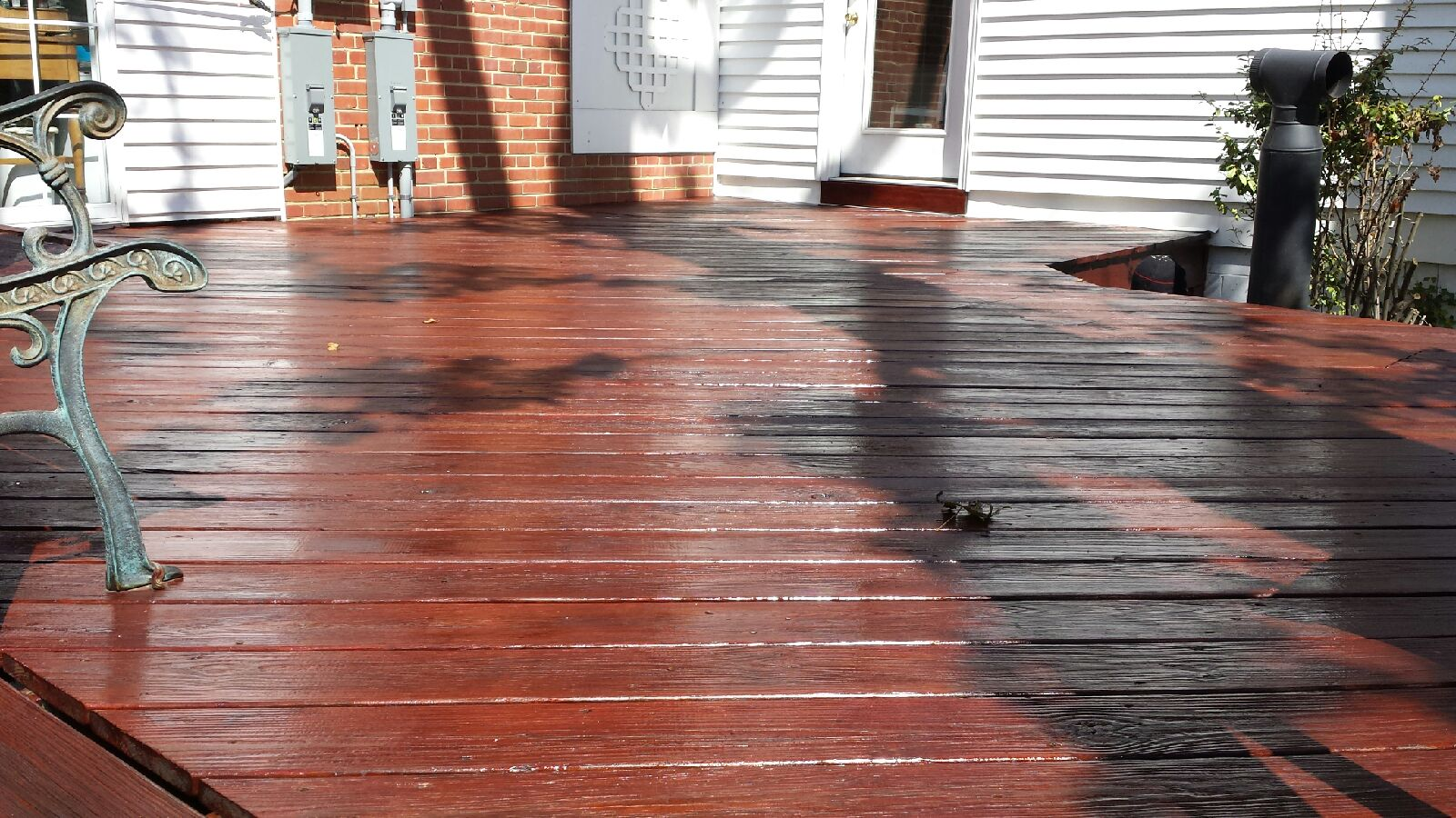 Deck pressure washed and stained by Global Painting RVA